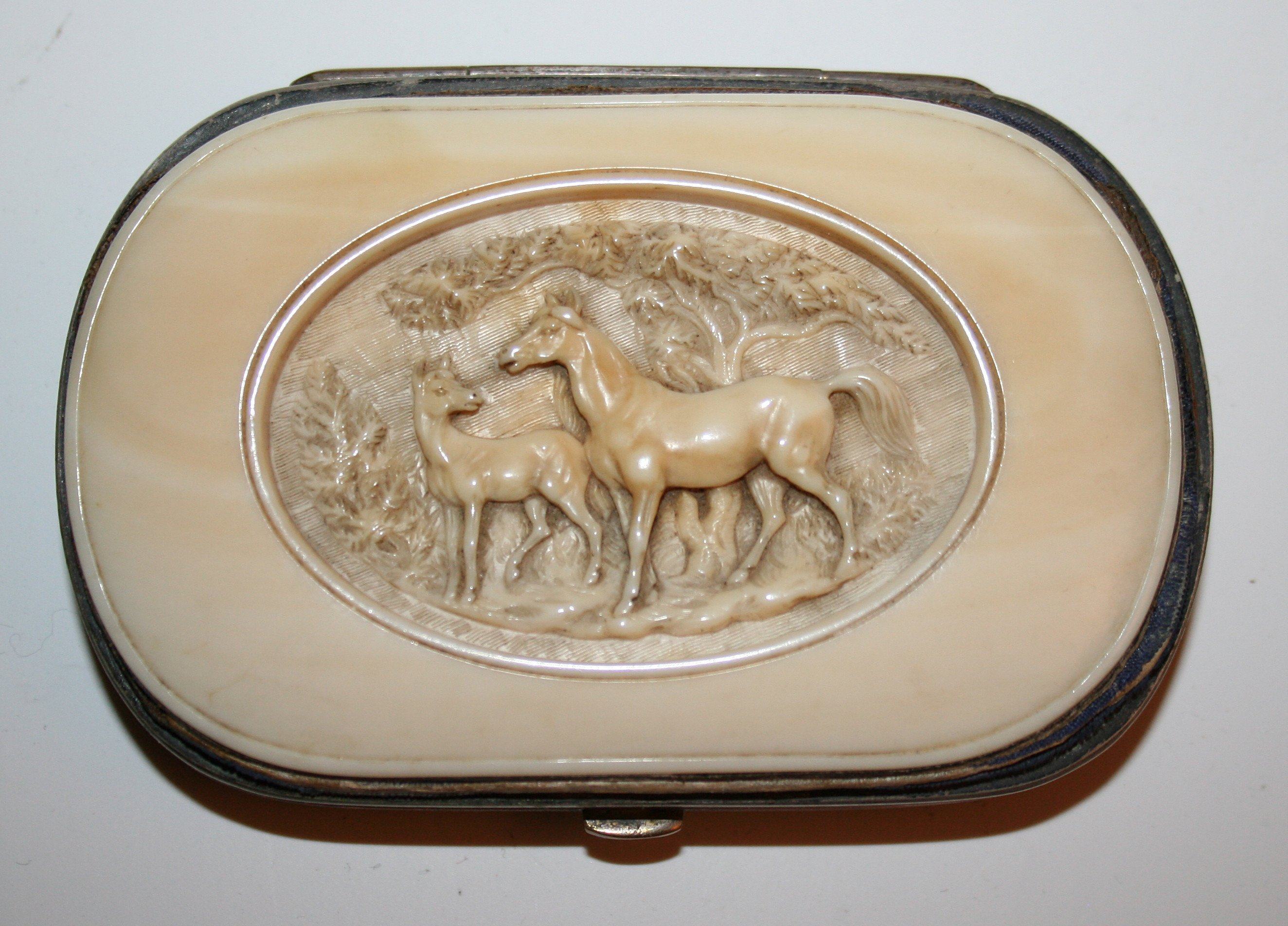 Carved Ivory Horses
