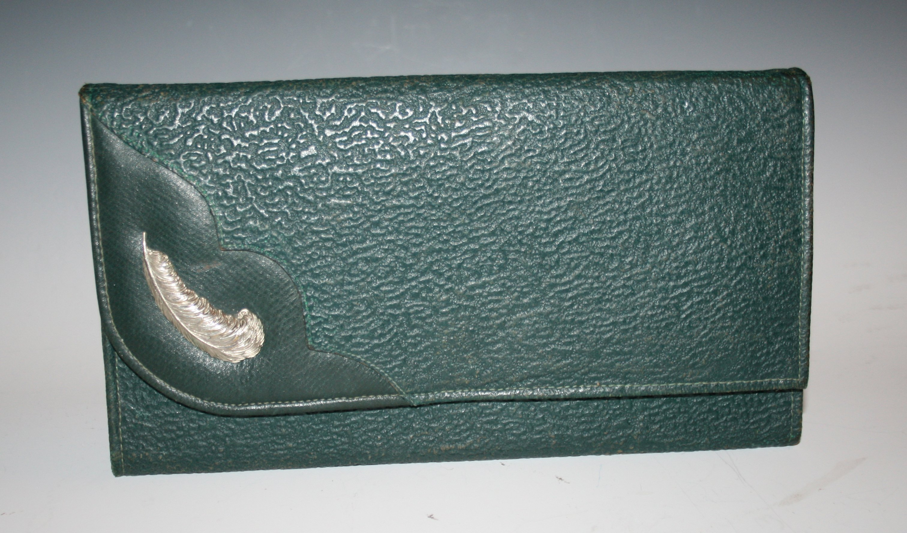 Green leather purse with a feather