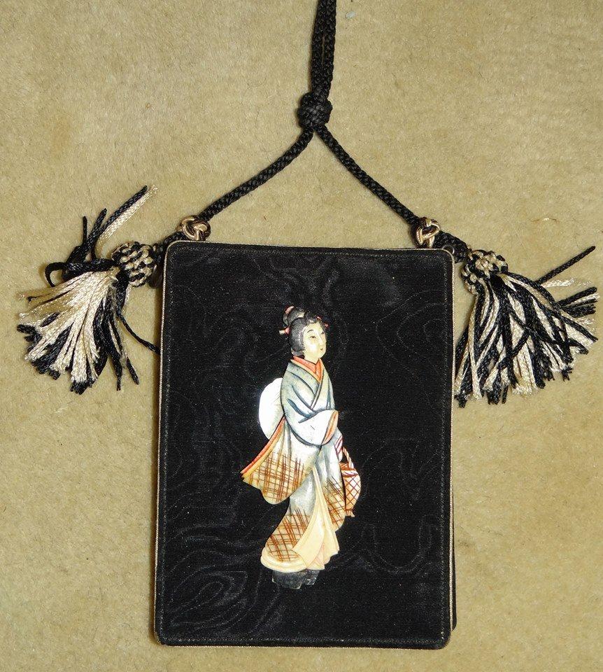 Carved bone and silk purse