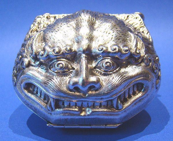 Silver devil purse